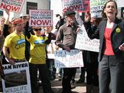 A Duke Energy official accepted a petition from protesters Feb. 25, 2014, after a the crowd shouted chants outside the Charlotte energy giant's headquarter on South Tryon Street.
