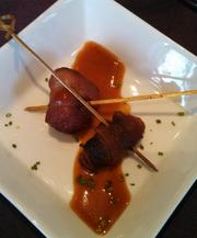 Bacon-wrapped dates are on the menu at Apropoe's.