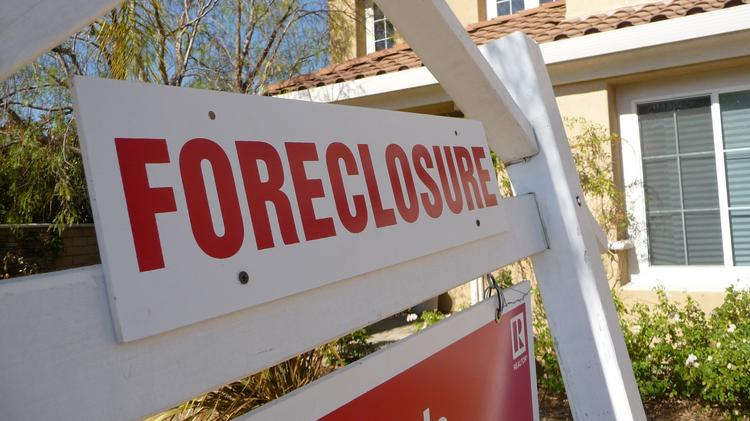A nonprofit group alleges that Deutsche Bank foreclosure properties in Chicago were treated differently based on the race of nearby residents.