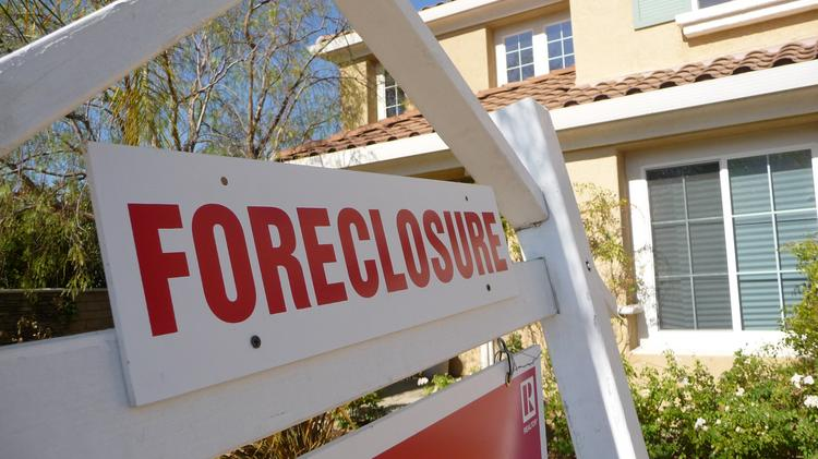 Housing foreclosure rates in the Los Angeles area stayed flat in January compared with December but foreclosure inventory fell sharply compared with a year ago.