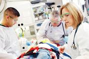 Emergency room personnel care for a patient in 2005 at Children's Medical Center.