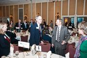 U.S. Rep. Jim Cooper, middle left, talks with other event attendees.