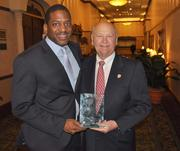 William Shelton of YMCA of Broward County with H. Wayne Huizenga holds the Great Floridian Award given to him by Gov. Rick Scott.