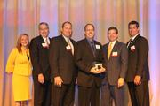 Finalist Doug Berkoff, center, flanked by sponsors and TBBJ President and Publisher Bridgette Bello.