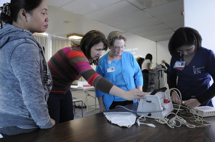 Sutter Health nurses Marynor Julian, left, Ana Maria Micu and Jeanne Larsen take an emergency-response class from ICU nurse and instructor Chimbee Joven.