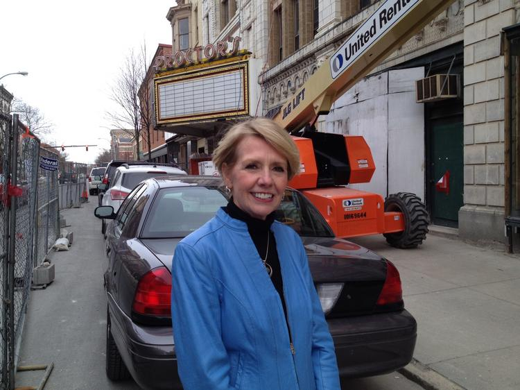 Rensselaer County Chamber of Commerce President Linda Hillman stands outside Proctor's Theater in downtown Troy, NY. Her organization has signed a 10-year lease to occupy part of the building. The chamber plans to move in by Sept. 1.