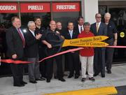 Ribbon cutting with Scott Faulkner, store Manager and Mario Andretti.
