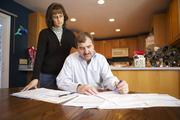 John Diemoz and his wife, Vreni, in their Glenwood Springs kitchen. Diemoz, owner of a construction business, estimates that he will spend an extra $140,000 in health care costs over the next 10 years to keep his business in Garfield County.