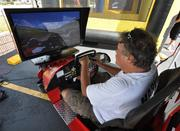 John Cesaro tries the Firestone Indy Car simulator.