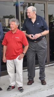 Mario Andretti and Stu Watterson, president and CEO of Tires Plus.