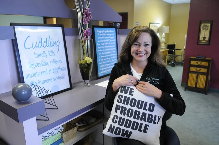 """Kelly Peterson is owner and """"chief cuddler"""" at Cuddle Connection."""
