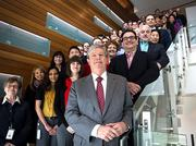 A group of Ph.D.s that work at Quintiles pose for a portrait at the Durham office. Quintiles has more than 950 Ph.D.s working for the organization globally.