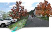 """Railroad Avenue in Midland after vegetated filter strips and bicycle """"sharrow"""" symbols have been added along with a new shared parking lot to the south. The vegetated filter strip will manage stormwater runoff from both the shared parking lot and Railroad Avenue."""