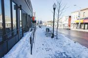 Many people didn't want to trudge through snowy sidewalks and parking lots in Baltimore's Highlandtown, above, and across the region so they just stayed away. Businesses say they couldn't compete with the warmth of customers' homes — and their numbers reflect it.