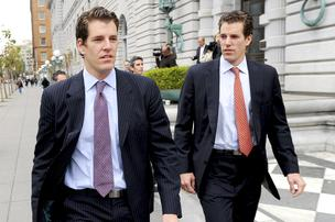 Cameron Winklevoss, right, and his twin brother Tyler leave a federal appeals court in San Francisco, California, U.S., on Tuesday, Jan. 11, 2011. Next week they'll be in court to speak about their new venture, bitcoin.