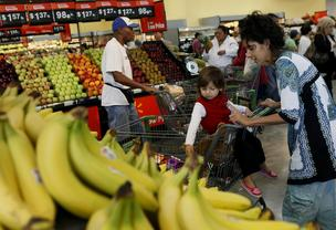 Wal-Mart  is the largest grocer in the United States. Here, shoppers browse for produce at a store in Panorama City, California.