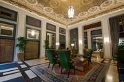 """The Sentinel Hotel's lobby celebrates its Northwest history with warm natural colors — and in a nod to its past as """"The Governor Hotel,"""" the rug is from Atiyah Brothers."""