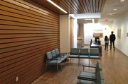 Wood panels hide material to reduce noise, keeping things calm and quiet.