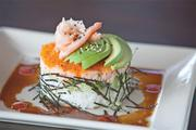 Yard House's California roll, sushi rice cake with cucumber, crab, tobiko, avocado and wasabi soy