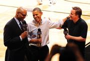 President Barack Obama and British Prime Minister David Cameron are interviewed by Clark Kellogg of CBS Sports at UD Arena for the First Four in 2012.