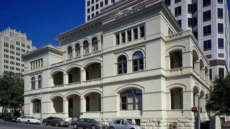 The O. Henry Hall at West Sixth and Lavaca streets will be available for private companies to lease now that the University of Texas has decided to consolidate its downtown staff into a new nine-story building around the block.