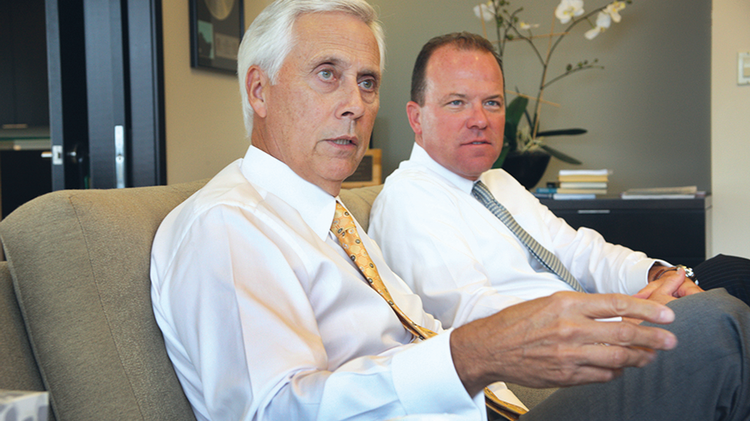 Umpqua Holdings CEO Ray Davis (left) and Sterling Bank CEO Greg Seibly (right) first discussed a deal between the banks in November 2012. This week, Sterling and its Argent Bank branches begin converting to Umpqua locations.