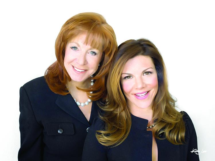 Susan Feil (left) and Alicia Feil-Peterson of Coldwell Banker Legacy specialize in selling luxury homes.