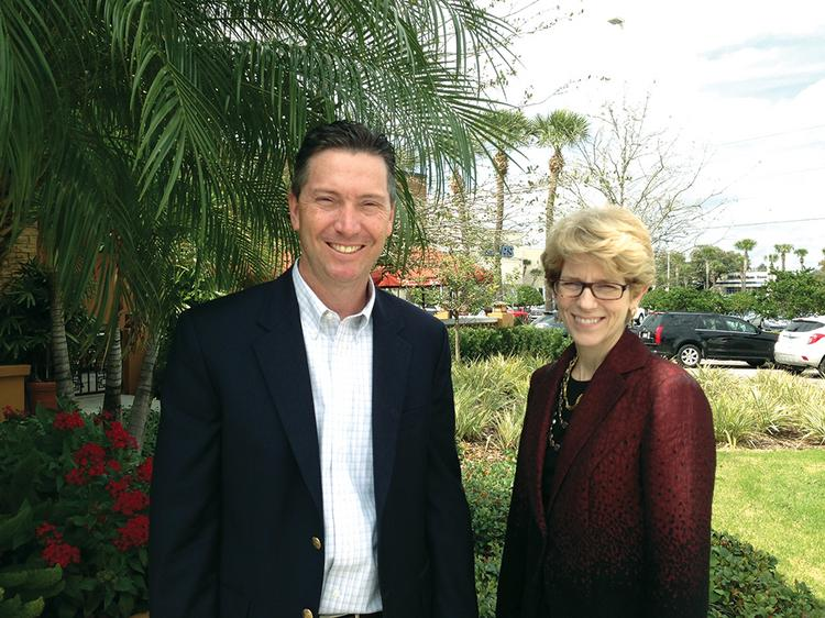 Michael Quackenbush Jr., Tampa managing partner, and Mary-Helen Horne, director, administrative services for PricewaterhouseCoopers