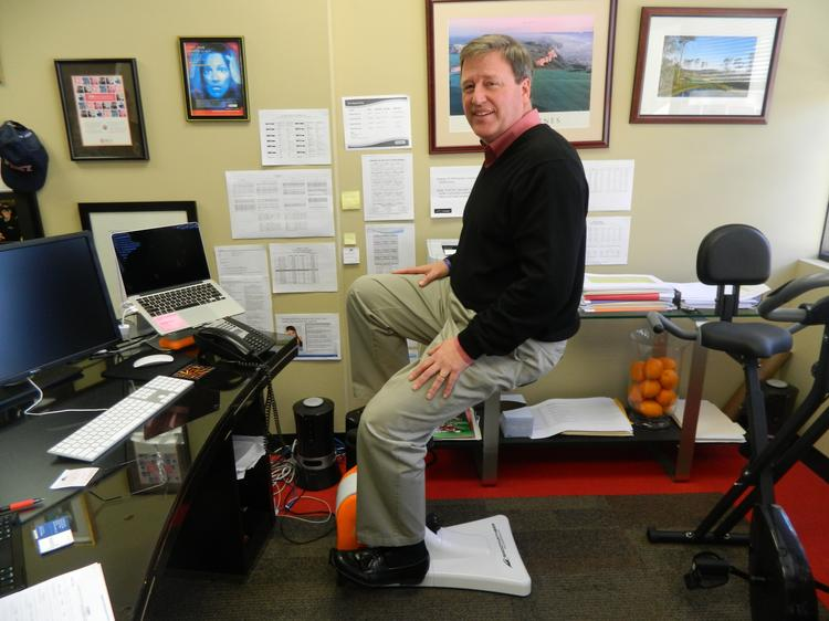 Smooth Fitness CEO Richard Hebert demonstrates the SitNCycle in his King of Prussia office.