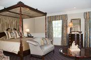 A master bedroom in the expansive home.