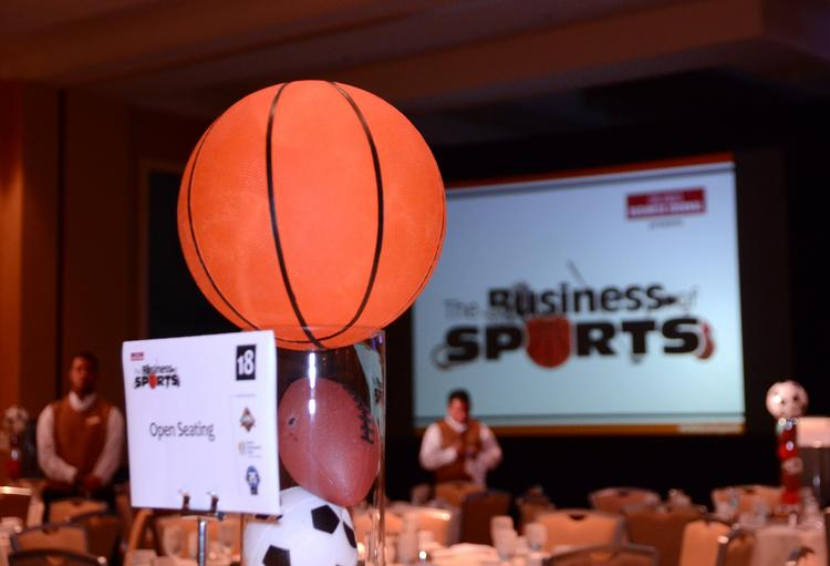 Appropriate decor awaits guests in the Hilton Orlando ballroom for OBJ's The Business of Sports event.