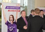 Guests network near the Orlando City Soccer display outside the ballroom.