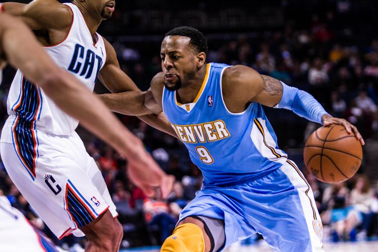 Andre Iguodala, seen in this February 2013 file photo playing for the Denver Nuggets against the Charlotte Bobcats, tells ESPN The Magazine's Bay Area issue that he's Oracle Corp. CEO Larry Ellison's biggest fan. Iguodala is now a forward with the Golden State Warriors in California.