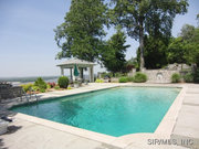 5 South Fairmount Drive: An in-ground swimming pool is surrounded by gardens.