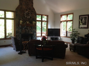 4822 Shadowbrook Lane: The home features fireplaces.