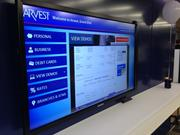 Arvest Bank offers a large touchscreen monitor in the lobby of its newest branch at 13th and Grand in Kansas City, allowing guests to peruse all the bank's offerings while they wait.