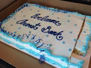 Neighbors dropped off a cake to help celebrate the grand opening of Arvest Bank's new branch in near the Kansas City Power & Light District.