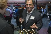 Barry Kluger of Knoodle, samples the treats.
