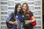 Katie McCartin, with ADP, and Allison Feldman, of Molnlycke Healthcare, spare a moment for the camera at the 2014 Book of Lists Party.