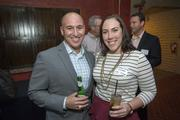 Hector Ramirez and Christina Caroll, of Viawest, enjoy the Book of Lists Party Feb. 27.