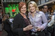 Deborah Kines, with DataBank, and Whitney Murray of Fennemore Craig raise a glass at the Book of Lists Party.