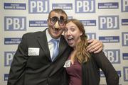 Ryan Ehrich, sales manager at Holiday Inn & Suites, Phoenix Airport and Katherine Stuart,an  account executive with Skyline, goof off for the camera at the Book of Lists Party.
