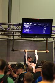 Competitions such as the pull-up bar are scattered throughout the exhibit hall and entice passers by to try their skills.