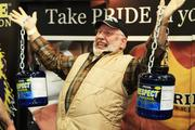 Sixty-six year old Don Coldington hoists two 20-pound jugs.