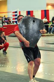 Participants in the strongman competition have to carry 400 pounds across the floor.