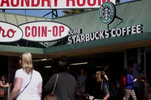 Customers wait in line to enter the Dumb Starbucks Coffee store, a parody of the Starbucks Corp. coffee chain, in Los Angeles, on February 10, 2014. Health authorities shut the shop down before the intellectual property issue was decided upon.