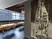 Natural light, views of Midtown, Coke bottle painting by Steve Penley.