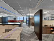 Glass partitions and clerestory glazing minimize the separation between management and staff.