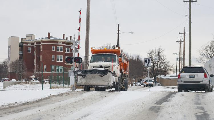 A snowplow clears the roads in Germantown. A proposal would forgive as many as 10 snow days in Kentucky.