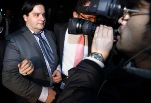 A television photographer, right, films Mark Karpeles, chief executive officer of Mt. Gox, leaving the Tokyo District Court in Tokyo, Japan, on Friday, February 28, 2014. Mt. Gox, once the world's largest Bitcoin exchange, filed for bankruptcy in Japan, focusing attention on the digital currency's risks.